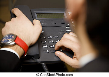 making a phonecall - young businessman making a phonecall in...