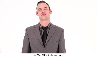 Young businessman making an affirmative gesture