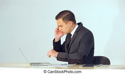 Young businessman making data in the laptop