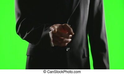 Young businessman making hand gestures in a virtual business environment on green screen