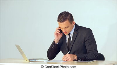 Young businessman making notes in a notebook
