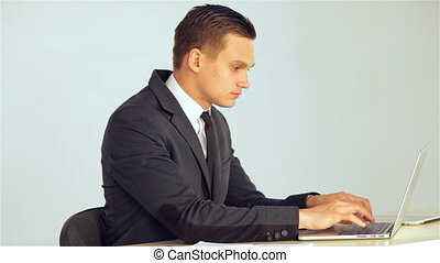 Young businessman making the data on the laptop