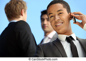 Young businessman on a cellphone