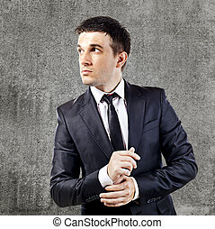 young businessman on grunge background