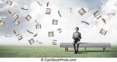 Young businessman or student studying the science and books fly
