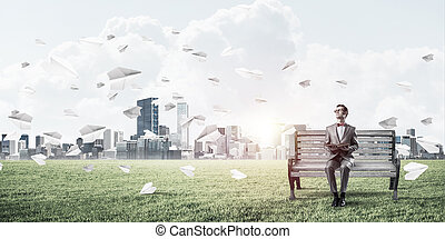 Young businessman or student studying the science and paper plan