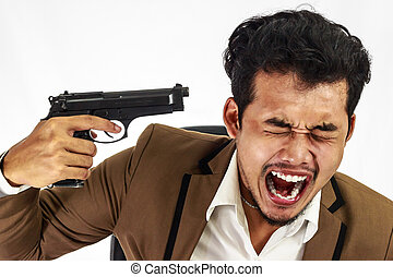 Young businessman pointing a gun at his head