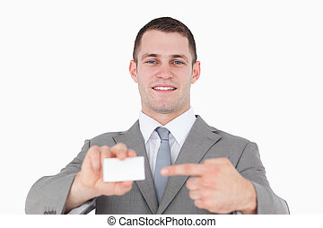 Young businessman pointing at a blank business card