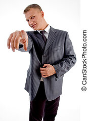 young businessman pointing at camera