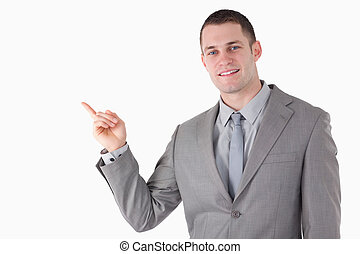 Young businessman pointing at something