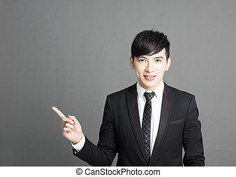 young Businessman pointing copy space