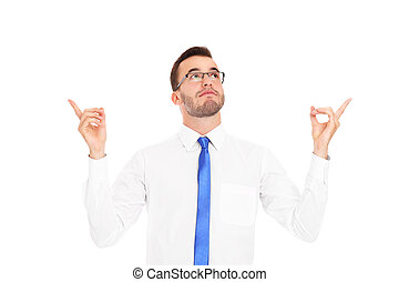 Young businessman pointing over white background