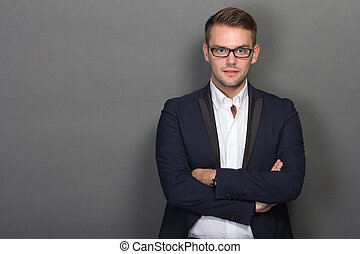 Young businessman posing chic with glasses on