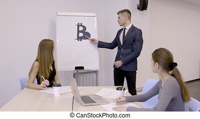 Young businessman presenting his bitcoin investment plan to...