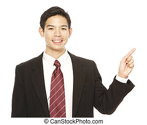 Man in business attire pointing and presenting