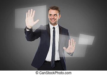 Young businessman push againts virtual screen