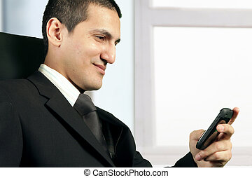 Young businessman reading message