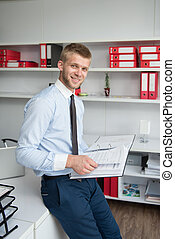 Young Businessman Reading Some Papers In Office