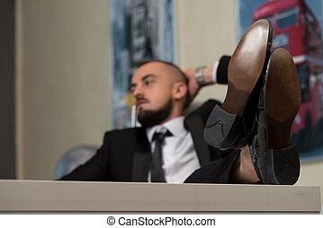 Young Businessman Relaxes In His Office