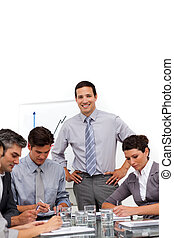 Young businessman reporting sales figures in a meeting