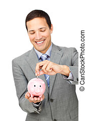 Young businessman saving money in a piggy-bank