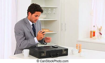 Young businessman shaving off and drinking quickly before go...