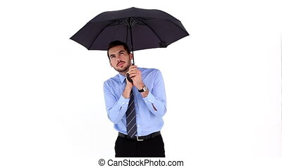 Young businessman sheltering