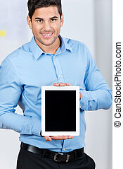 Young businessman showing a tablet