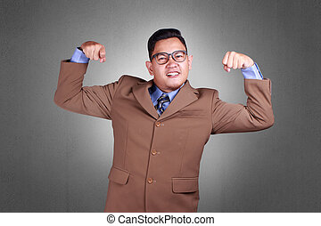 Young Businessman Showing Muscle, Strong Gesture