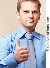young businessman showing thumbs up sign