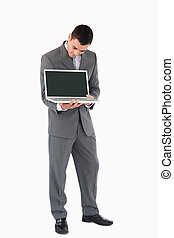 Young businessman showing whats on his screen against a ...