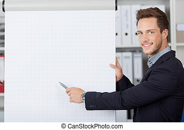 Young Businessman Shows Free Space On Flipchart - Portrait...