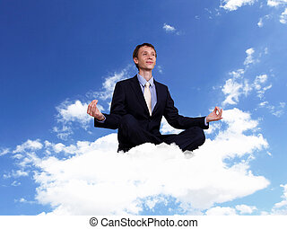 Young businessman sitting and praying