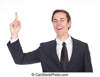 Young businessman smiling and pointing finger