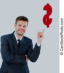 young businessman smiling and points at the the dollar symbol.