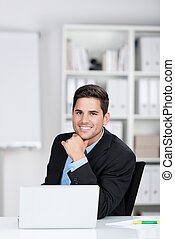 Young businessman smiling for the camera