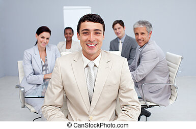 Young businessman smiling in a meeting