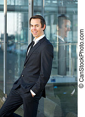Young businessman smiling outdoors