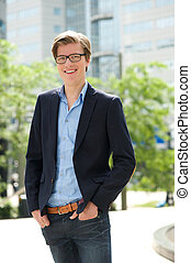 Young businessman smiling