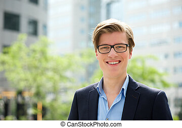 Young businessman smiling with glasses
