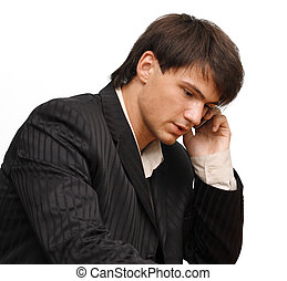 Young businessman speaking by cell phone