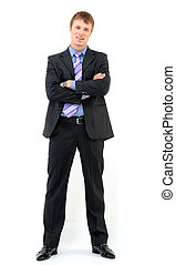Young businessman standing against isolated white background