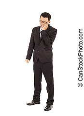 young businessman standing and in agony with a toothache