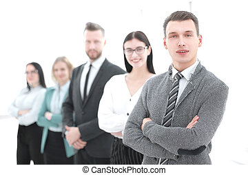 young businessman standing in front of his business team