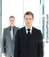Young businessman standing in front of the camera