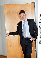 Young Businessman Standing With Hand On Hip