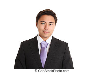 Young businessman wearing a suit and tie. White background.