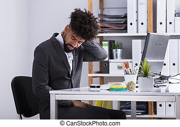 Businessman Suffering From Neck Pain - Young Businessman...