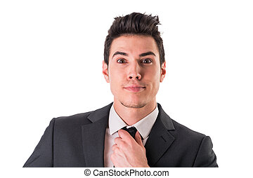 Young businessman surprised posing