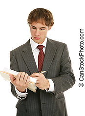 Young Businessman Takes Notes - Handsome young businessman...